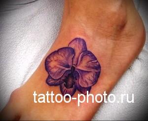 тату орхидея внизу ноги девушки фото