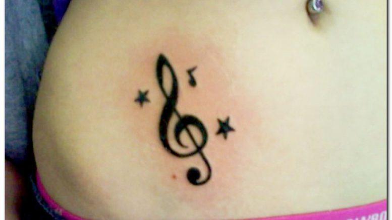 Значение татуировки «Скрипичный ключ» - фото