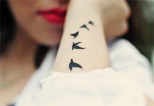 Значения татуировок с изображением птиц - фото