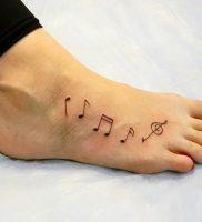 фото тату с нотами от 16.11.2017 №068 — tattoo with notes — tattoo-photo.ru