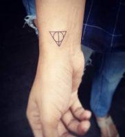 фото тату Дары Смерти от 20.02.2018 №140 — Deathly Tattoo — tattoo-photo.ru