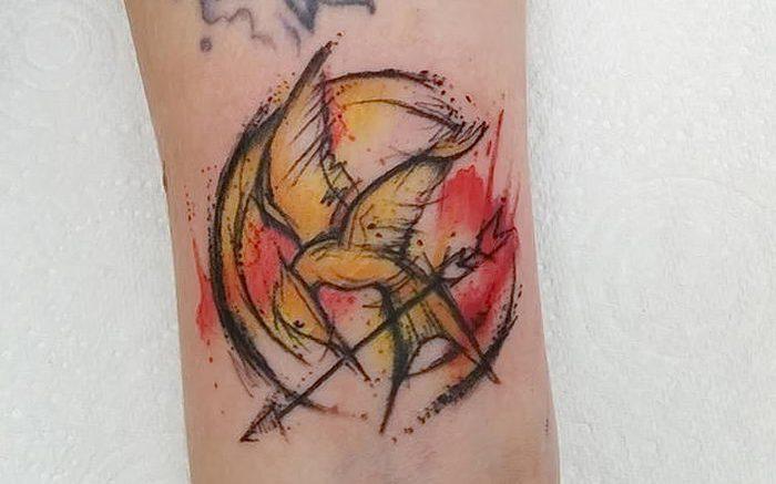 фото тату Сойка Пересмешница от 03.01.2018 №005 - Tattoo MOCKINGJAY - tattoo-photo.ru