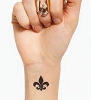 фото тату королевская лилия от 08.04.2018 №002 — tattoo royal lily — tattoo-photo.ru