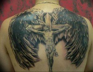фото тату Распятие 01.05.2019 №023 - crucifix tattoo - tattoo-photo.ru