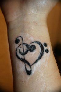 фото тату басовый ключ 01.05.2019 №040 - tattoo bass clef - tattoo-photo.ru
