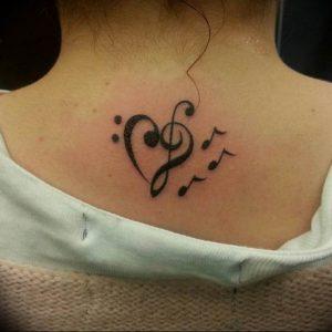 фото тату басовый ключ 01.05.2019 №061 - tattoo bass clef - tattoo-photo.ru