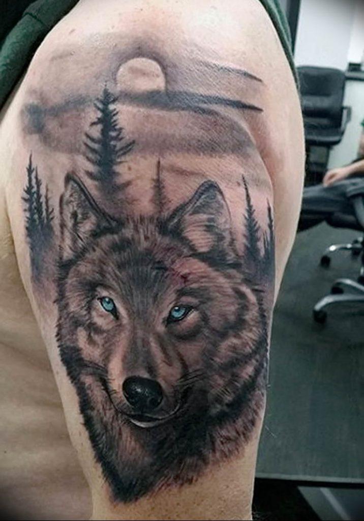 фото тату идущий волк как